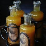 bottles of Harry Potter pumpkin juice ready for a party